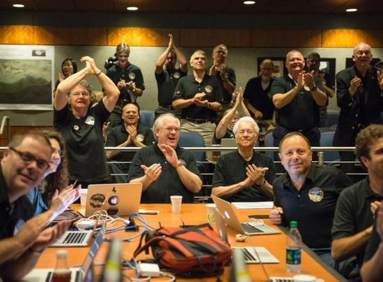 The New Horizons team celebrates the new image of Pluto
