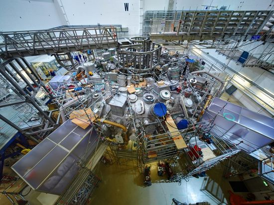 MPI1 - The outside of the Wendelstein 7-x stellarator with its conglomeration of equipment, ports, and supporting structure