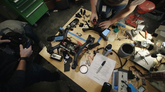 A pair of 3D Robotics Solo drones being assembled by 3DR engineers