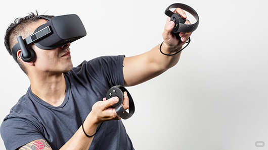 Gamer using the consumer Oculus Rift headset and Oculus Touch sensors to play an Xbox game