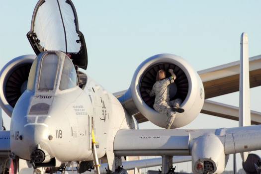 Airman Jill Hallandsworth performs a preflight engine check on an A-10 Thunderbolt II during an overall aircraft inspection Sept. 25, 2009, at Whiteman Air Force Base, Mo