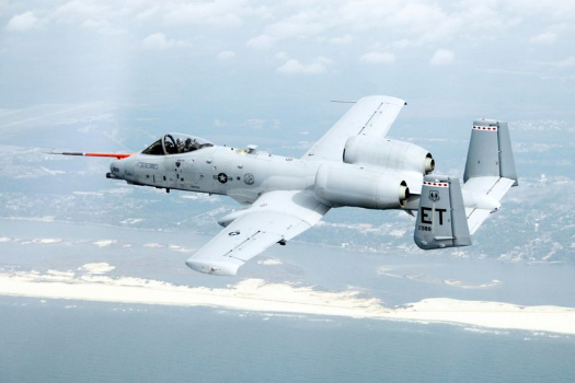 An A-10C Thunderbolt II from Eglin Air Force Base, Fla., flies along the coast of Florida March 25, 2010, during the first flight of an aircraft powered solely by a biomass-derived jet fuel blend