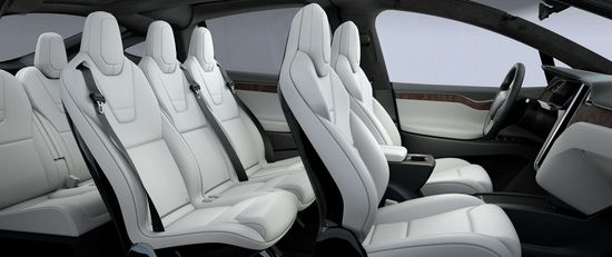 Tesla Model X all-electric SUV is equipped with seven passenger seats. The third row has two fold-down seats