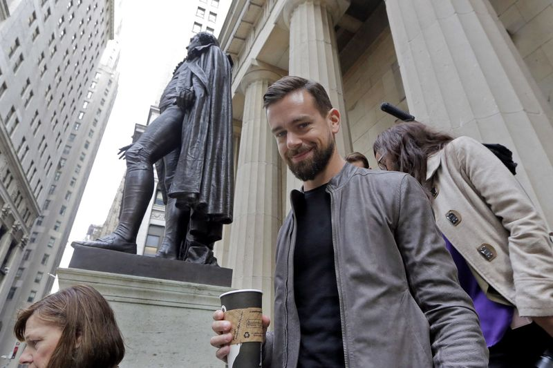 Square CEO Jack Dorsey passes the statue of George Washington after posing for photos before his company's IPO at the New York Stock Exchange, Thursday, Nov. 19, 2015