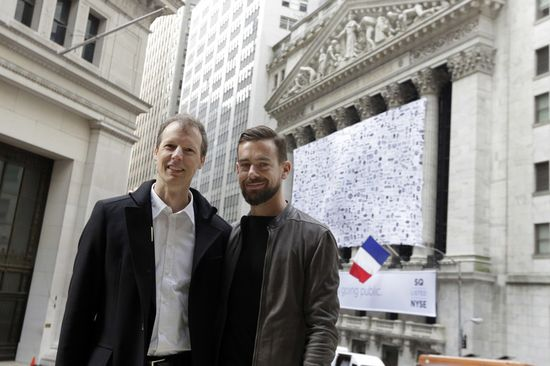Square CEO Jack Dorsey, right, poses with co-founder Jim McKelvey in front of the NYSE before opening bell ceremonies, Thursday, Nov. 19, 2015