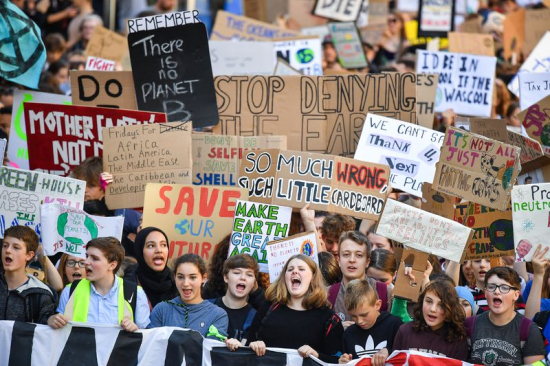 Young people around he world take to the streets to demand action on global warming and end to use of fossil fuels